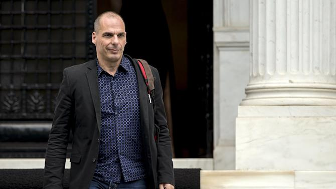 File picture shows Greek Finance Minister Yanis Varoufakis leaves after a meeting at the office of Prime Minister Alexis Tsipras in Maximos Mansion in Athens