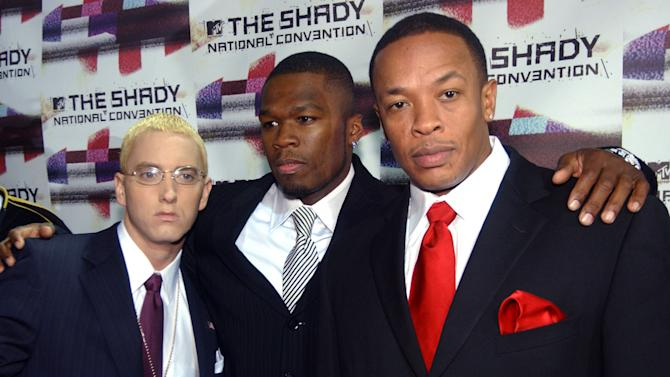 """FILE - Rappers Eminem, left, 50 Cent, center, and Dr. Dre pose for photographers after arriving at the Roseland Ballroom for a concert """"The Shady National Convention,"""" in this Oct. 28, 2004 file photo taken in New York. The rumors were true: Eminem joined 50 Cent to recreate """"Get Rich or Die Tryin'"""" at South By Southwest Friday March 16, 2012. While Dr. Dre didn't show, Eminem joined 50 on """"Patiently Waiting"""" and a short encore that almost didn't come off because of lackluster crowd reaction.  (AP Photo/Ramin Talaie)"""