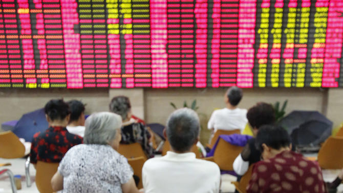 An investor takes a nap at a private securities company Tuesday, Sept. 4, 2012, in Shanghai, China. Asian stock markets fell Tuesday as uncertainty persisted about what authorities in the U.S., China and Europe might do to deal with a souring global economy. (AP Photo)