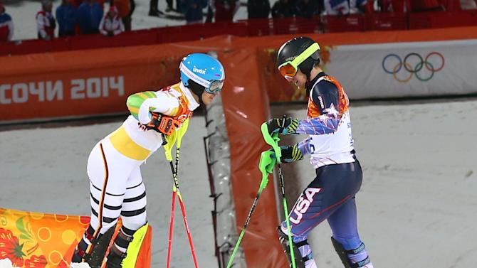 United States' Ted Ligety, right, and Germany's Felix Neureuther talk after they both skied out of the second run of the men's slalom at the Sochi 2014 Winter Olympics, Saturday, Feb. 22, 2014, in Krasnaya Polyana, Russia. (AP Photo/Alessandro Trovati)