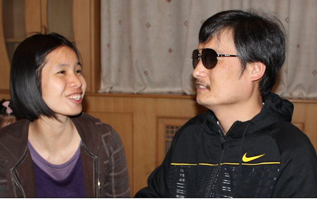 In this photo taken in late April, 2012, and released by Hu Jia, blind Chinese legal activist Chen Guangcheng, right, meets with Zeng Jinyan, the wife of human rights activist Hu Jia, at an undisclosed location in Beijing. Chen, an inspirational figure in China's rights movement, slipped away from his well-guarded rural village on April 22, 2012, and made it to a secret location in Beijing on Friday, April 27. Activists say Chen is under the protection of U.S. diplomats in Beijing. (AP Photo/Hu Jia)