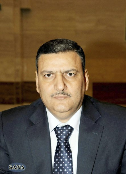 File handout photo shows Syria's former agriculture minister Riyad Hijab, who has been named as new prime minister