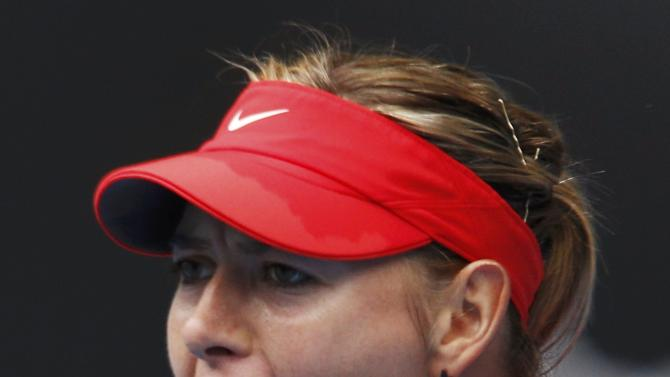 Sharapova of Russia reacts after winning a point against Bouchard of Canada during their women's singles quarter-final match at the Australian Open 2015 tennis tournament in Melbourne