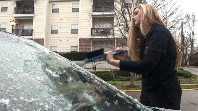 Marlowe Whittaker removes ice from her car Friday, Jan. 25, 2013, in Knoxville, Tenn. Tennessee has declared a state of emergency as a precautionary measure to get emergency operations under way as the eastern portion of the state continues to see significant icing.  (AP Photo/The Knoxville News Sentinel, J. Miles Cary)