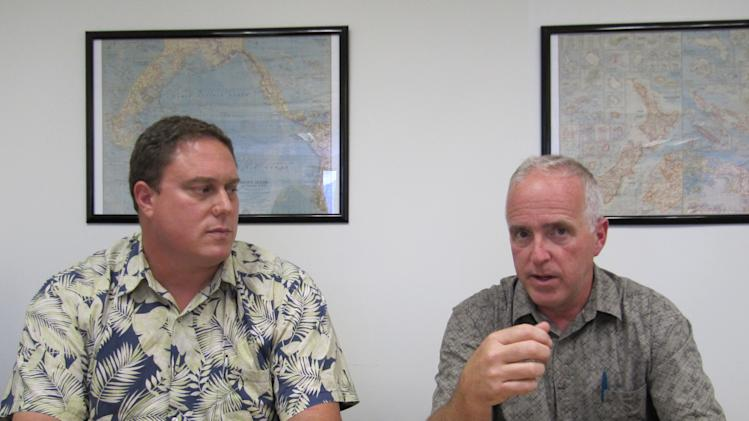John Van Dame, right, U.S. Pacific Fleet senior environmental planner, and Roy Sokolowski, a U.S. Pacific Fleet sonar modeling expert, speak in Honolulu on Thursday, May 10, 2012 about the Navy's new environmental impact statement for training and testing in Hawaii and California waters. The U.S. Navy says its training and testing using sonar and explosives could potentially hurt more dolphins and whales in Hawaii and California waters than previously thought. (AP Photo/Audrey McAvoy)
