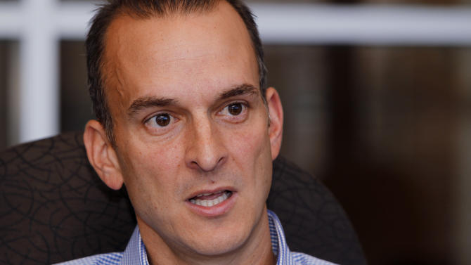 In this photo taken, Tuesday, Oct. 16, 2012, Travis Tygart, the CEO of the U.S. Anti-Doping Agency, speaks during an interview at his office in Colorado Springs, Colo. As head of the USADA, his mission is to make sports a sanctuary for finding out who's most talented and who worked the hardest, not who's the best cheater. Most recently, that mission has led him to spearhead the case that's ended lance Armstrong's cycling and triathlon careers. (AP Photo/Ed Andrieski)