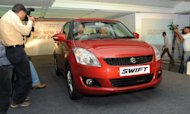 A photographer snaps a Swift on display at a launch in Ahmedabad, India last year. Japan&#39;s Suzuki Motor is to recall about 109,000 Swift subcompact cars worldwide, half of them in Japan, to repair a defect that may cause petrol leakage
