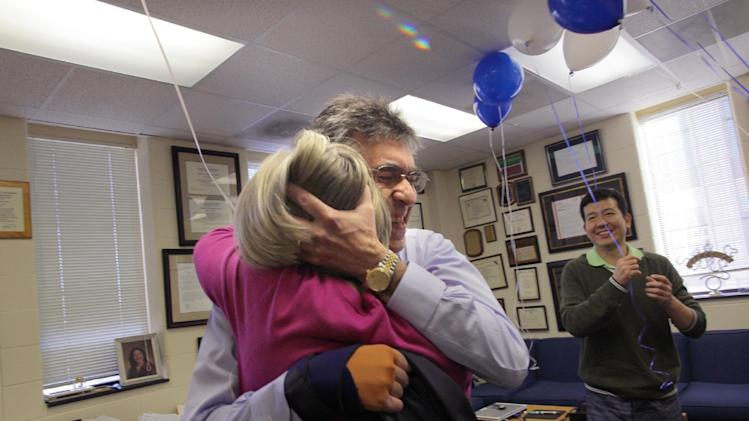 Dr. Robert Lefkowitz of Duke University hugs his adminstrative assistant of 35 years, Donna Addison, in Lefkowitz' office at Duke on Wednesday, Oct. 10, 2012, the day Lefkowitz heard he had won the 2012 Nobel Prize in chemistry. Lefkowitz and Brian Kobilka of Stanford University School of Medicine won the Nobel Prize in chemistry Wednesday for studies of protein receptors that let body cells sense and respond to outside signals like danger or the flavor of food. Such studies are key for developing better drugs. (AP Photo//Ted Richardson)