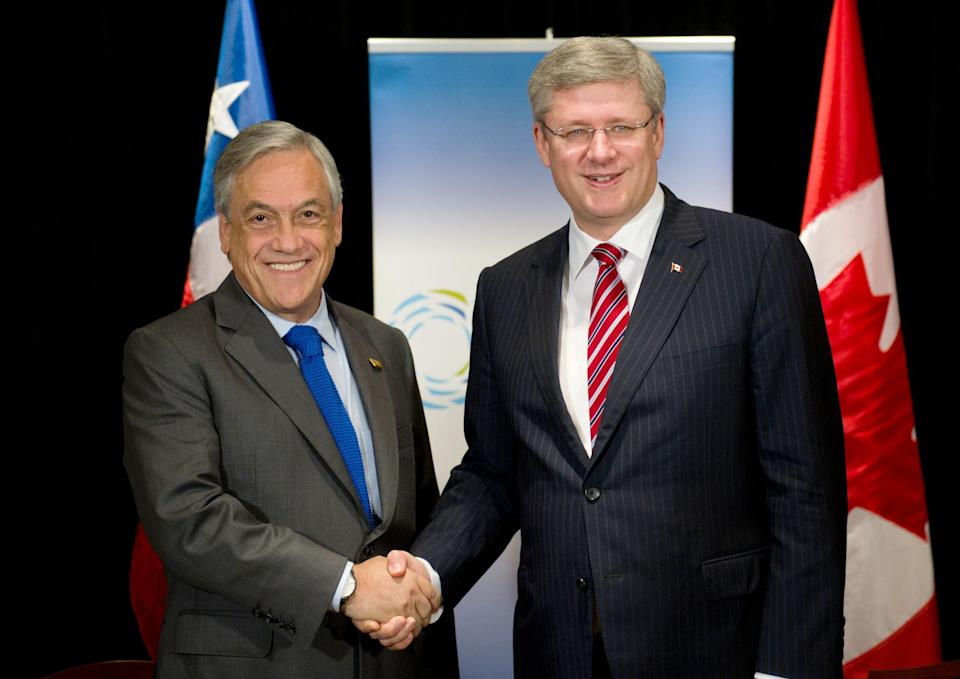 Chilean President Sebastian Pinera Echenique, left, meets with Canadian Prime Minister Stephen Harper during the 2011 APEC Summit in Honolulu, Hawaii on Saturday, Nov. 12, 2011. (AP Photo/The Canadian Press, Sean Kilpatrick)