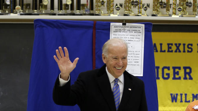 Vice President Joe Biden waves as he exits a voting booth after casting his ballot at Alexis I. duPont High School, Tuesday, Nov. 6, 2012, in Greenville, Del. (AP Photo/Matt Rourke)