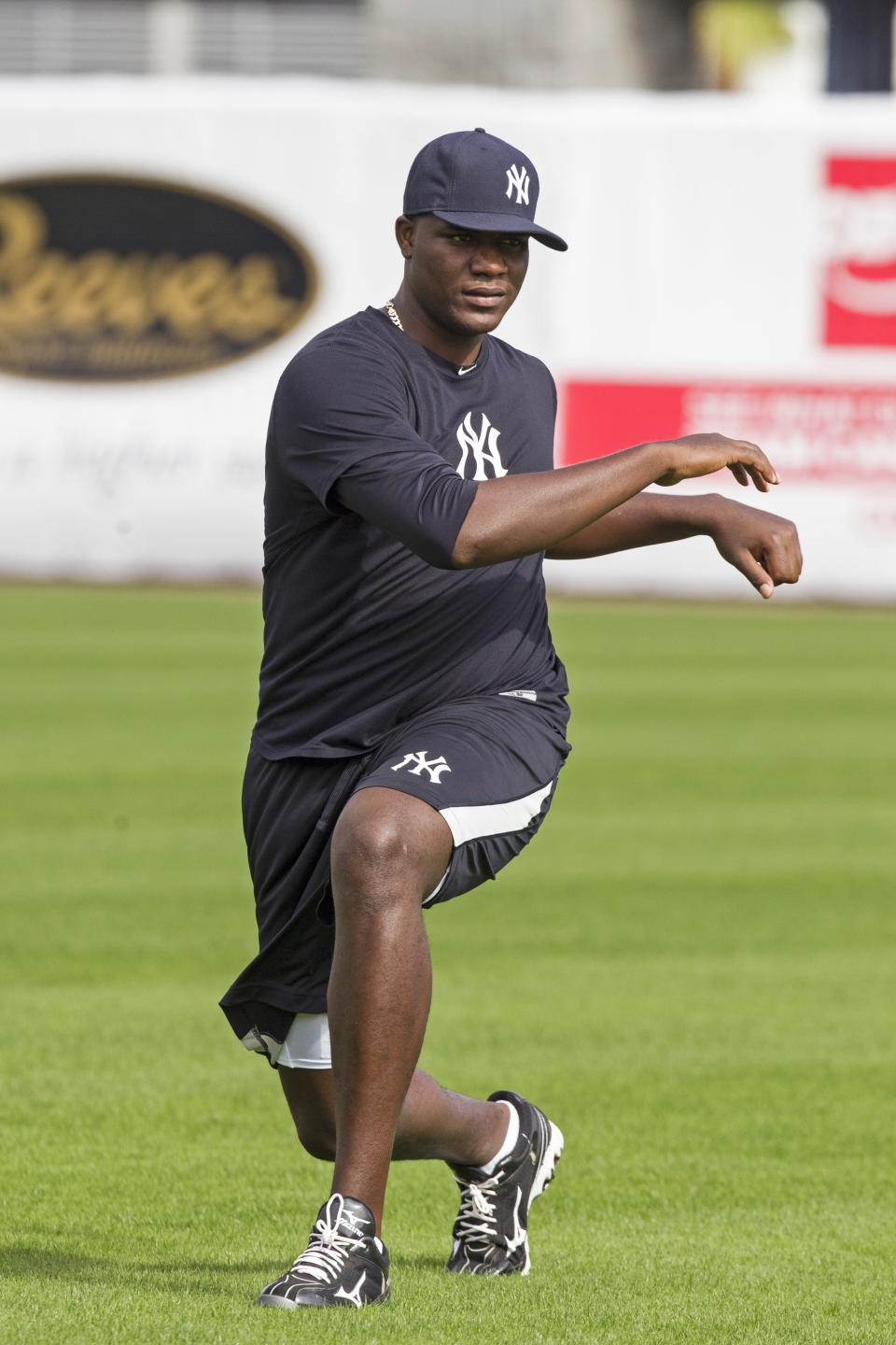 New York Yankees pitcher Michael Pineda stretches during baseball spring training at George M. Steinbrenner Field Tuesday, Feb. 12, 2013, in Tampa, Fla. (AP Photo/Scott Iskowitz)