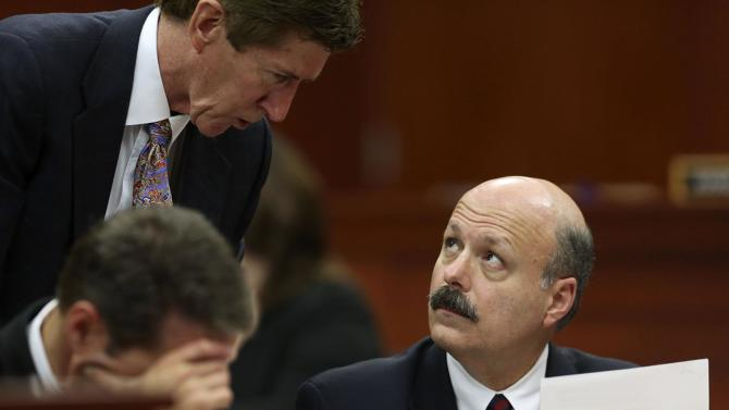 Defense attorney Mark O'Mara, left, talks with assistant state attorney Bernie de la Rionda, right, during jury selection in the George Zimmerman trial in Seminole circuit court in Sanford, Fla., Thursday, June 20, 2013. Zimmerman has been charged with second-degree murder for the 2012 shooting death of Trayvon Martin.(AP Photo/Orlando Sentinel, Gary Green, Pool)
