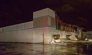 The Books-A-Million store is seen damaged by heavy …