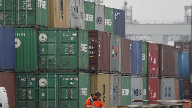 Containers are piled up at the Duisburg harbour, Germany, Thursday, Feb. 14, 2013. The German economy shrank by a larger-than-expected 0.6 percent in the final quarter in 2012, official figures showed Thursday, Feb. 14, 2013, in a clear sign that the European financial crisis took its toll on the continent's largest economy. The quarterly decline was primarily due to a drop in exports as demand weakened from other European nations, many of which are in recession, the Federal Statistical Office said. (AP Photo/Frank Augstein)