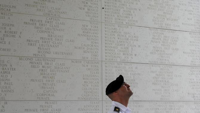 A U.S Army Ranger views the names of fallen U.S. soldiers inside the memorial hall after a U.S. Memorial Day ceremony at the American Cemetery in Taguig city, metro Manila