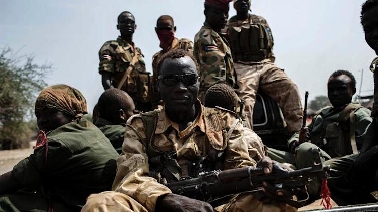 Government forces loyal to South Sudan's President Salva Kiir patrol on February 5, 2014 the area near Mingkaman to prevent attacks by rebel forces