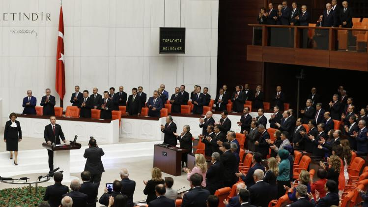 Turkey's new President Erdogan attends a swearing in ceremony at the parliament in Ankara