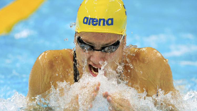 Sweden's Jennie Johansson competes in the women's 100-meter breaststroke on day 1 of the FINA/ARENA Swimming World Cup, in Dubai, United Arab Emirates, Tuesday, Oct 2, 2012. (AP Photo/Stephen Hindley)