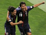 Ryoichi Maeda (right) celebrates with his teammate Shinji Okazaki after scoring against Iraq World Cup qualifier in Saitama, suburban Tokyo on Tuesday. Asian champions Japan shrugged off the late injury withdrawal of Manchester United's Shinji Kagawa to beat Iraq 1-0 and stay top of their group in 2014 World Cup qualifying on Tuesday