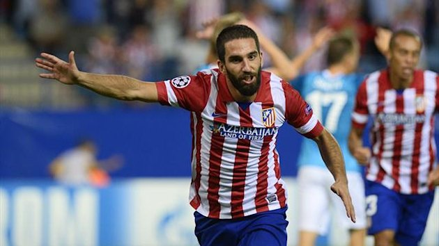 Atletico Madrid's Turkish midfielder Arda Turan celebrates after scoring against Zenit St Petersburg (AFP)