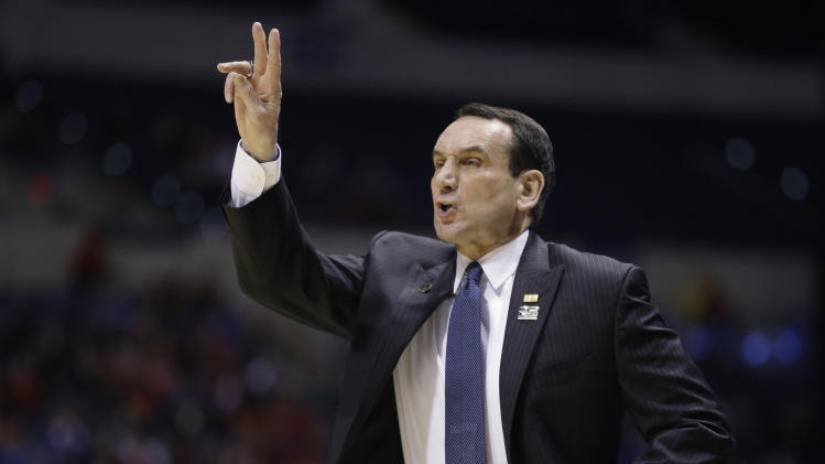 Duke head coach Mike Krzyzewski directs his team during the first half of a regional semifinal against Michigan State in the NCAA college basketball tournament, Friday, March 29, 2013, in Indianapolis. (AP Photo/Michael Conroy)