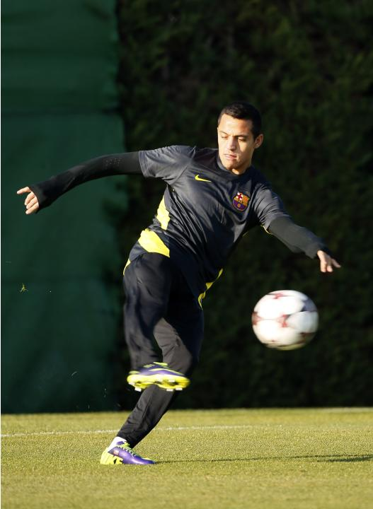 FC Barcelona's player Alexis Sanchez controls the ball during the training session at Ciutat Esportiva Joan Gamper in Sant Joan Despi near Barcelona