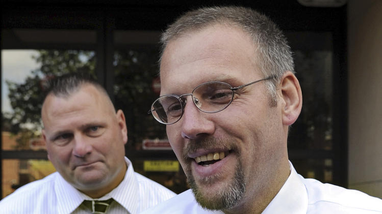 In this Aug. 19, 2009, file photo, a smiling Kenneth Ireland leaves Superior Court in New Haven, Conn., after all charges were dropped against him in connection with the rape and murder of Barbara Pelkey. New DNA evidence proved he did not commit the crimes. Ireland filed a wrongful imprisonment claim against the state seeking up to $8 million, and a hearing begins Tuesday, July 29, 2014, to determine how much he should be compensated. (AP Photo/Bob Child, File)