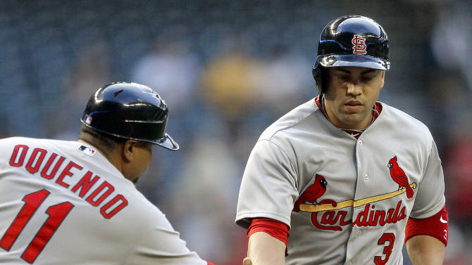 St. Louis Cardinals' Carlos Beltran (3) is congratulated by third base coach Jose Qquendo (11) after hitting a home against the Arizona Diamondbacks during the first inning of a baseball game Tuesday, May 8, 2012, in Phoenix. (AP Photo/Matt York)