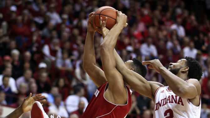 Indiana forward Christian Watford (2) fouls Wisconsin forward Ryan Evans during the first half of an NCAA college basketball game, Tuesday, Jan. 15, 2013, in Bloomington, Ind. (AP Photo/Darron Cummings)