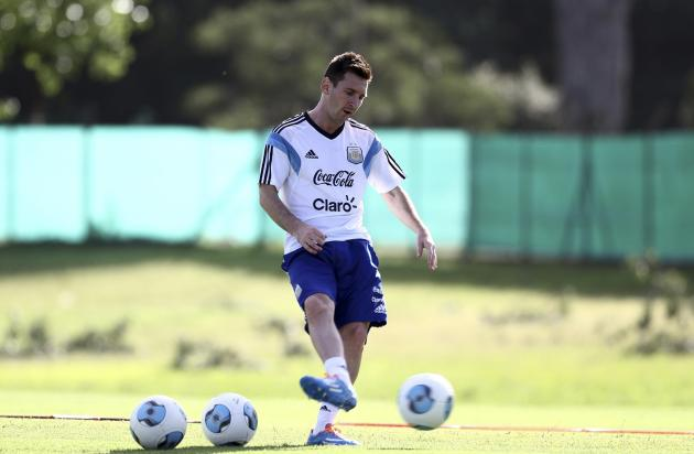 Handout photo of Argentine striker Messi kicking a ball during a training session at the squad's headquarters in Buenos Aires