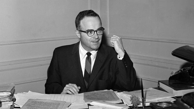 FILE - In this March 22, 1961, file photo, Walter Byers, executive director of the NCAA, sits at his desk in Kansas City, Mo. Byers, the first executive director of the NCAA who spent 36 years leading and shaping the organization, has died. He was 93. (AP Photo/File)