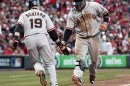 San Francisco Giants Third Baseman Pablo Sandoval Slaps Hands With Teammate Marco Scutaro During Game 4 Of Their MLB NLDS Playoff Baseball Series Against The Cincinnati Reds In Cincinnati