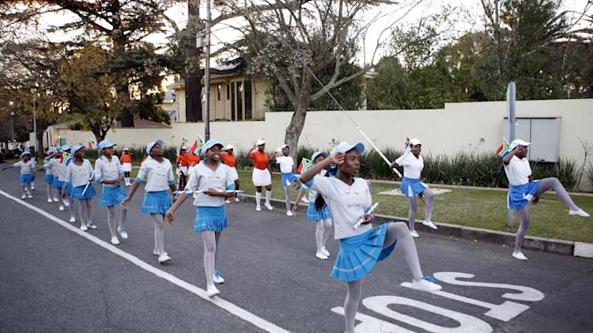Soweto African Kids perform outside the home of the former President Nelson Mandela in Johannesburg, South Africa, Saturday, June 15, 2013. Mandela, remains in the hospital for a seventh day. The 94-year-old was hospitalized on Saturday for a recurring lung infection. (AP Photo/Themba Hadebe)