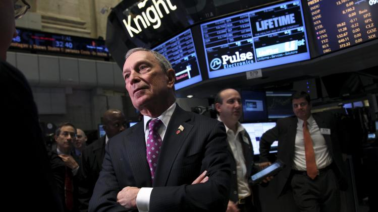 Mayor Michael Bloomberg talks to traders before ringing the opening bell at the New York Stock Exchange in New York, Wednesday, Oct. 31, 2012. Traffic is snarled, subways out of commission, streets flooded and power out in many parts of the city, but the New York Stock Exchange opened without hitch Wednesday after an historic two-day shutdown, courtesy of Hurricane Sandy.  (AP Photo/Seth Wenig)