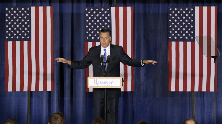 "In this May 15, 2012, photo, Republican presidential candidate, former Massachusetts Gov. Mitt Romney speaks during a campaign stop in Des Moines, Iowa. When Republican Romney decried the ""prairie fire"" of U.S. debt Tuesday, he ignored some of the sparks that set it ablaze. One was the Great Recession that took hold before Barack Obama became president. That landmark event went unmentioned in Romney's speech. Another was a series of Bush-era tax cuts that Romney wants to follow with even lower rates.  (AP Photo/Charlie Neibergall)"