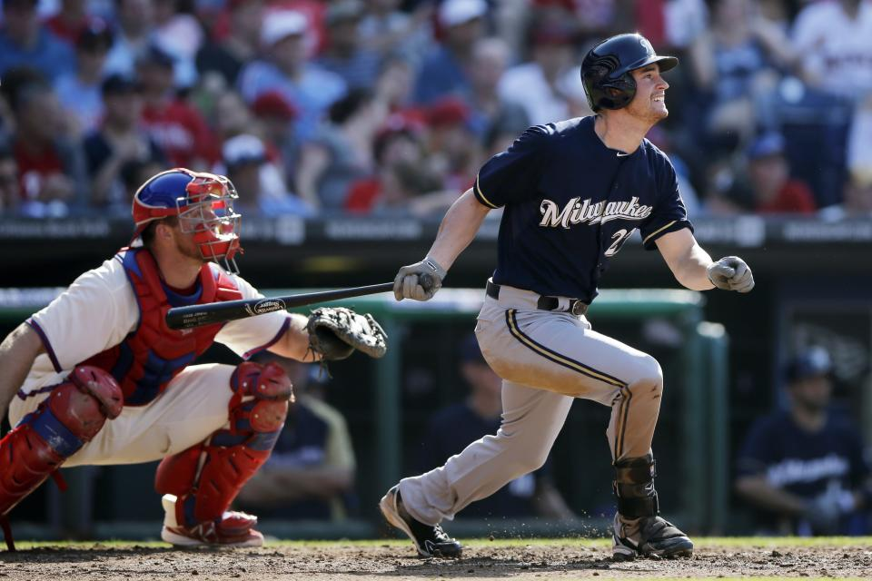 Milwaukee Brewers' Logan Schafer watches his double off Philadelphia Phillies starting pitcher Tyler Cloyd in the fourth inning of a baseball game, Saturday, June 1, 2013, in Philadelphia. At left is catcher schaErik Kratz. Milwaukee won 4-3. (AP Photo/Matt Slocum)