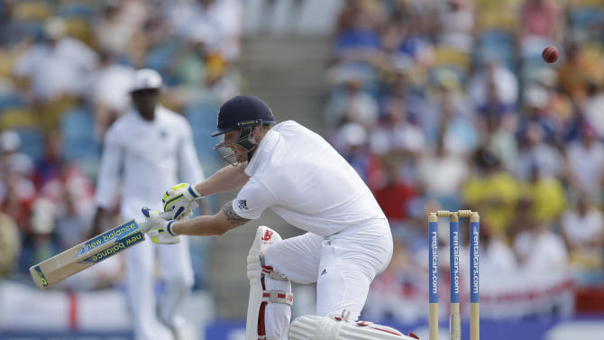 England's Ben Stokes plays a shot from the bowling of West Indies' Jerome Taylor during day three of their third Test match at the Kensington Oval in Bridgetown, Barbados, Sunday, May 3, 2015.  (AP Photo/Ricardo Mazalan)