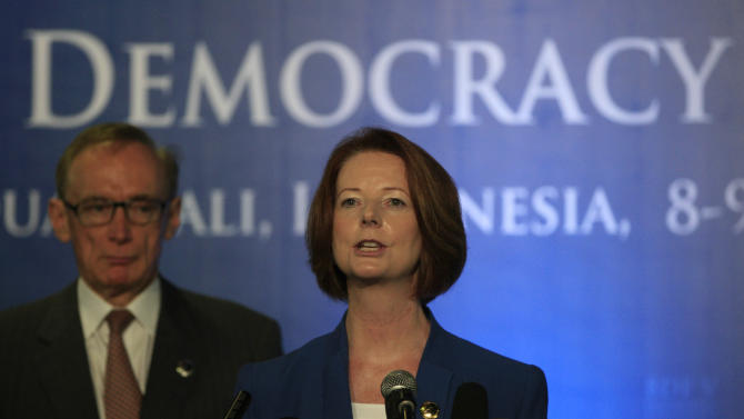 Australian Prime Minister Julia Gillard speaks to the media as Foreign Minister Bob Carr, left, listens during a press conference on the sidelines of the Bali Democracy Forum in Nusa Dua, Bali, Indonesia, Thursday, Nov. 8, 2012. (AP Photo/Dita Alangkara)