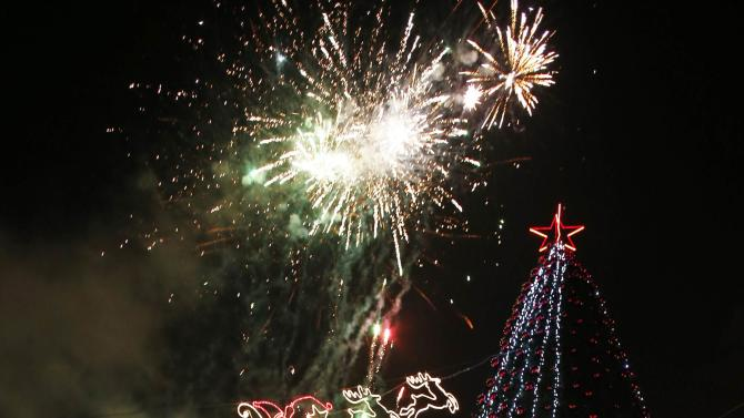 Fireworks explode during a Christmas tree lighting ceremony in Jerusalem's Old City