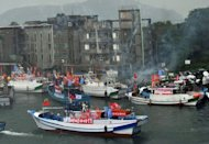 A flotilla of Taiwanese fishing boats, against a backdrop of fireworks, head to the disputed East China Sea islands, known as Senkaku in Japan and Diaoyu Islands in China, from a port in northeast Ilan county, on September 24. Dozens of Taiwanese boats including six coastguard vessels have entered the disputed waters Tuesday morning, according to Japanese coastguards