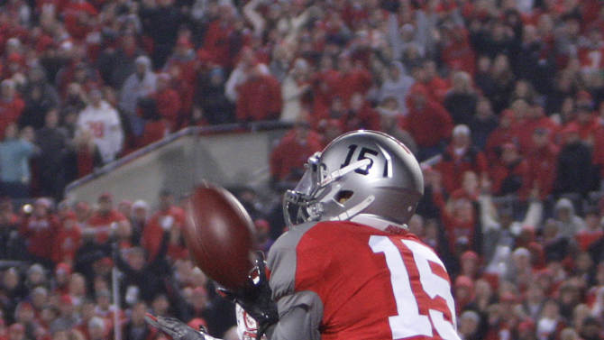 Ohio State's Devin Smith, right, catches the game-winning touchdown as Wisconsin's Marcus Cromartie defends during the fourth quarter of an NCAA college football game Saturday, Oct. 29, 2011, in Columbus, Ohio. Ohio State beat Wisconsin 33-29. (AP Photo/Jay LaPrete)