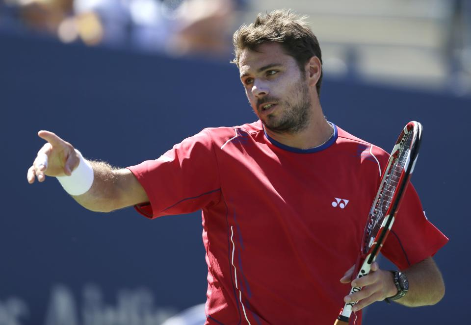 Stanislas Wawrinka, of Switzerland, reacts after a point against Novak Djokovic, of Serbia, during the semifinals of the 2013 U.S. Open tennis tournament, Saturday, Sept. 7, 2013, in New York. (AP Photo/Darron Cummings)