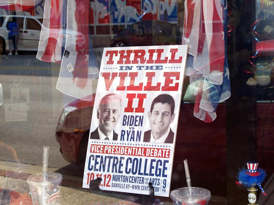 This Sept. 19, 2012, photo shows a sign in a business window touting the vice presidential debate at Centre College in downtown Danville, Ky. The debate is scheduled for Oct. 11 at the college, which hosted the 2000 vice presidential debate. (AP Photo/Bruce Schreiner)