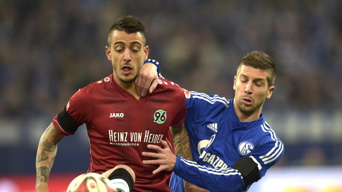 Hannover's Joselu from Spain, left, and Schalke's new defender Matija Nastasic from Serbia challenge for the ball during the German Bundesliga soccer match between FC Schalke 04 and Hannover 96, in Gelsenkirchen, Germany, Saturday, Jan. 31, 2015