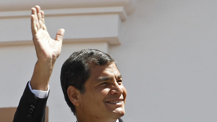 """Ecuador's President Rafael Correa greets passersby from the balcony of the presidential palace during the weekly, The Change of the Guard, in Quito, Ecuador, Monday, June 24, 2013. The Ecuadorian government declared Monday that national sovereignty and universal principles of human rights would govern their decision on granting asylum to Edward Snowden, powerful hints that the former National Security Agency contractor is welcome despite potential repercussions from Washington. Correa said on Twitter that """"we will take the decision that we feel most suitable, with absolute sovereignty."""" AP Photo/Dolores Ochoa))"""