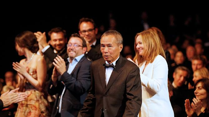Taiwanese director Hou Hsiao-Hsien reacts after being awarded with the Best Director prize during the closing ceremony of the 68th Cannes Film Festival in Cannes, France, on May 24, 2015