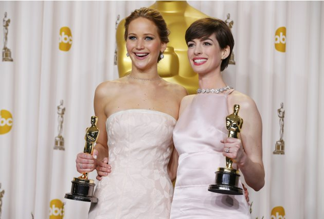 Jennifer Lawrence and Anne Hathaway pose with their Oscars backstage at the 85th Academy Awards in Hollywood, California