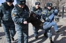 Russian police officers detain a supporter of jailed members of the punk group Pussy Riot during a protest calling for their release, in central Moscow