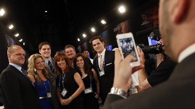 Luke Joeckel, third from left, a tackle from Texas A&M, poses for a photo in the green room before the first round of the NFL football draft, Thursday, April 25, 2013 at Radio City Music Hall in New York.  (AP Photo/Jason DeCrow)