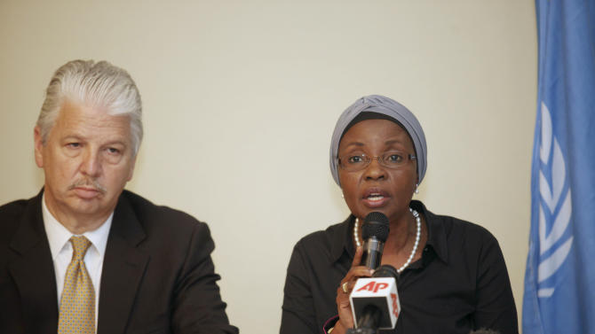 United Nation, Deputy Secretary-General, Dr. Asha-Rose Migiro, right, speak during a news conference, while U.N Security Chief Gregory Starr, right, listens  in Abuja, Nigeria, Sunday, Aug 28, 2011. The United Nations had no prior warnings or intelligence about threats against its Nigeria headquarters, the world body's security chief said Sunday, as top officials mourned the 23 killed in a suicide car bombing there. (AP Photo/Sunday Alamba)